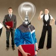 Stock Photo: Business Team With Lamp Head