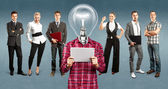 Business Team With Lamp Head — Stockfoto
