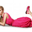 Blonde in pink dress lies on a floor — Stock Photo #4144267