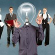 图库照片: Business Team With Lamp Head