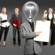 Business team with lamp head — Stock Photo #49574099