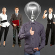 Business team with lamp head — Stock Photo #49574121