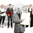 Business team with lamp head — Stock Photo #49575001