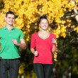 Young man and woman running - Stock Photo