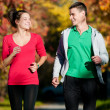 Stock Photo: Young man and woman running