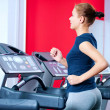 Stock Photo: Young womat gym run on on machine