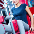 Woman at the gym exercising — Stock Photo #14530461