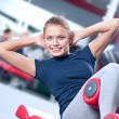 Stock Photo: Womat gym exercising