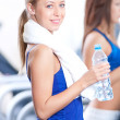 Women drinking water after sports — Stock Photo