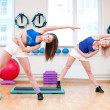 Women do stretching exercise - 