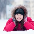 Happy young woman plays with a snow — Стоковое фото #14531409