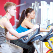 Stock Photo: In gym doing cardio cycling training