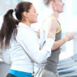 Royalty-Free Stock Photo: Woman and man at the gym exercising
