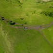 Beautiful small green mountain road with lake from above (aerial view) — Stock Photo #14531875