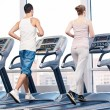 Woman and man at the gym exercising. — Foto de Stock