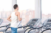 Man at the gym exercising. Run. — Stock Photo