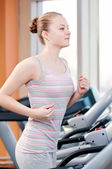 Woman at gym exercising. Run on machine — Stock Photo