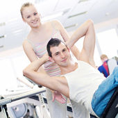 Gym man and woman doing exercise — Stock Photo