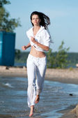 Sporty woman running on water — Стоковое фото