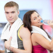 Man and woman drinking water after sports - ストック写真