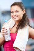 Woman drinking water after sports — Stock Photo