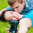 Royalty-Free Stock Photo: Happy teenage couple taking picture