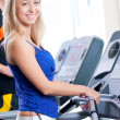 Two young women run on machine in the gym — Foto de Stock
