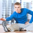 Man doing stretching exercises at the gym - ストック写真