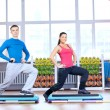 Man and woman at the gym doing stretching - Foto de Stock