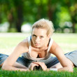 Young woman doing yoga exercise — Stock Photo