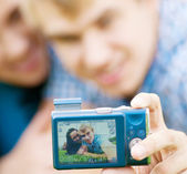 Happy teenage couple taking picture — Stock Photo