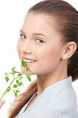 Young beauty woman with green parsley — Stock Photo