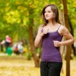 A young girl running in autumn park — Stock Photo #19942973