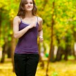A young girl running in autumn park — Stock Photo #19943019
