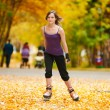 Woman on roller skates in the park — Stock Photo #19943151