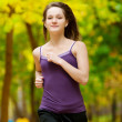 A young girl running in autumn park — Stock Photo #19943323