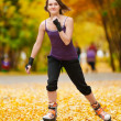 Stock Photo: Womon roller skates in park