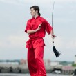 Wushoo man in red practice martial art — Stock Photo #19946283