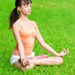 Teenage girl doing yoga exercise — Stock Photo #19951275