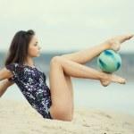 Young gymnast girl dance with ball — Stock Photo