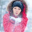 Happy young woman plays with a snow — Stock fotografie