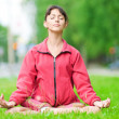 Teenage girl doing yoga exercise — Foto Stock