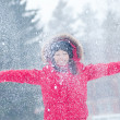 Happy young woman plays with a snow — ストック写真