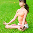 Teenage girl doing yoga exercise — Stock Photo