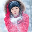 Happy young woman plays with a snow — Stockfoto