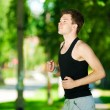 Royalty-Free Stock Photo: Young man jogging in park