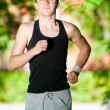 Young man jogging in park — Stock Photo #19954081