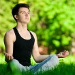 A young man doing yoga exercise — Stock Photo #19954131