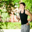 Young man jogging in park — Stock Photo