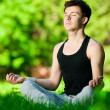 A young man doing yoga exercise — Stock Photo #19954181